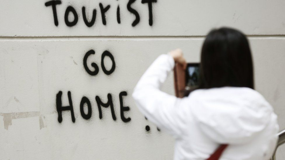 Tourist Go Home sign