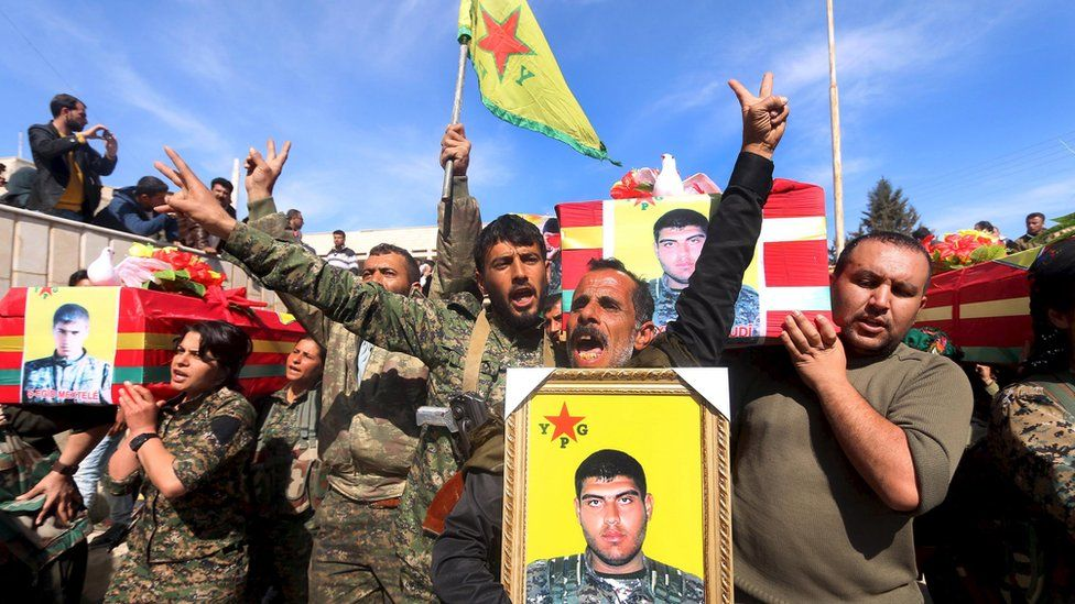 Fighters from the Syrian Kurdish Popular Protection Units (YPG) carry the coffins of comrades killed by Islamic State militants, at Ras al-Ain, Syria (2 March 2016)