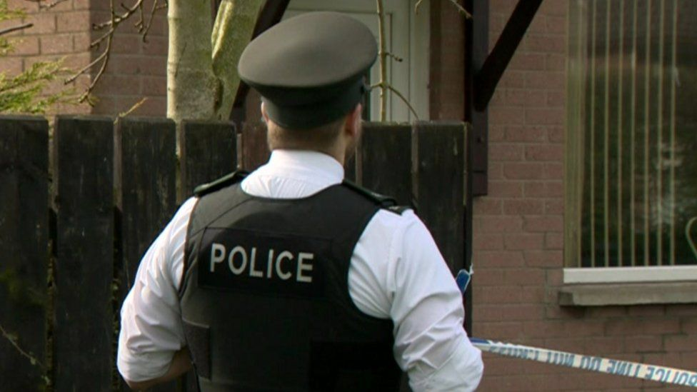 Police officer outside a house in Limavady