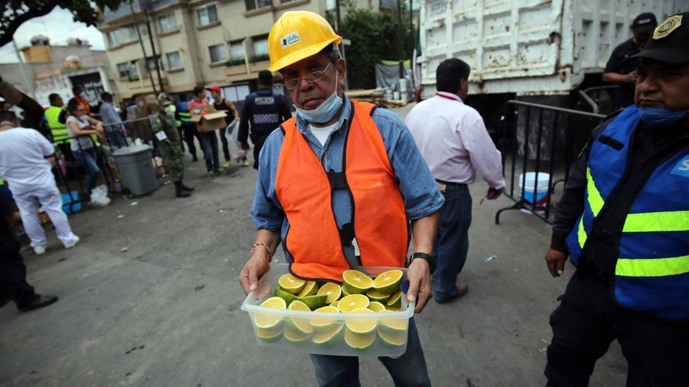 Volunteers kept workers, soldiers, medical staff and the media fed and hydrated with snacks and drinks often passed out from trays or small bags, Mexico City, 2017