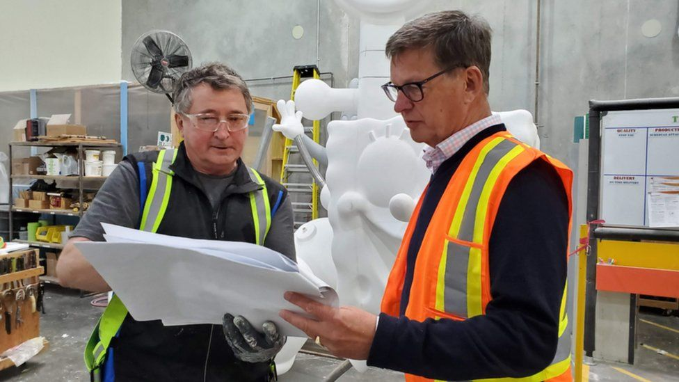 Geoff Chutter looking over plans with a Whitewater employee