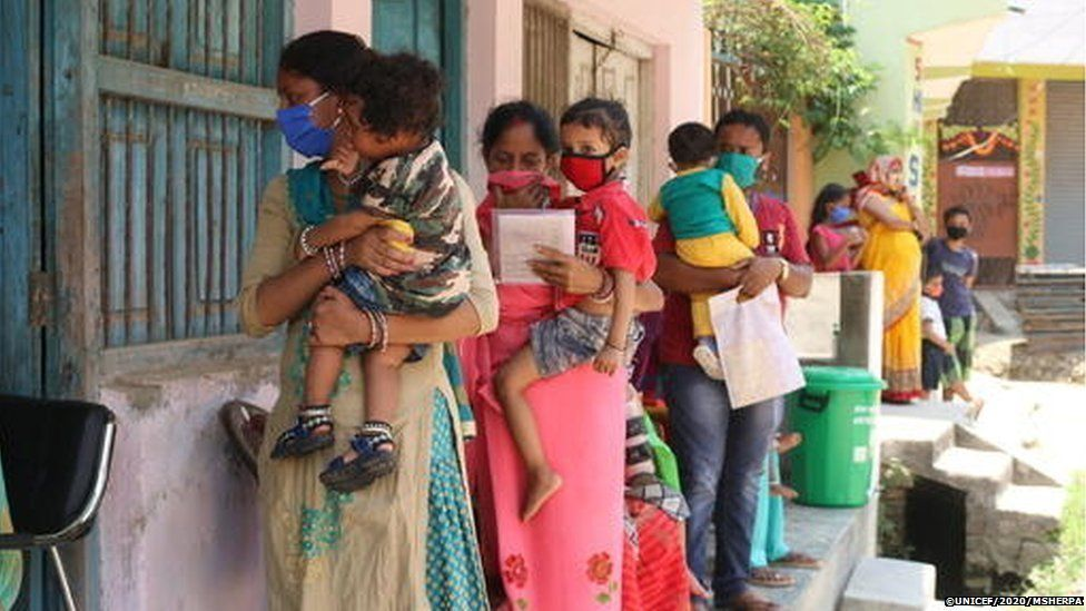 Parents and caregivers lined up with their children at an immunisation clinic in Janakpur Sub-Metropolitan City in southern Nepal.