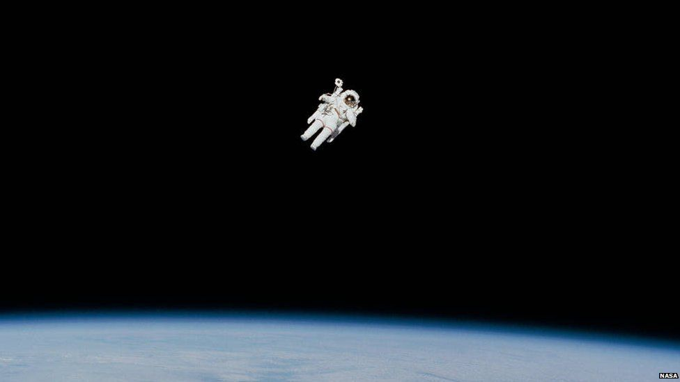 Astronaut floats in space