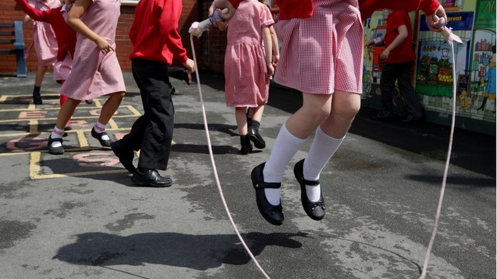 Children play hopscotch and skip rope during playtime