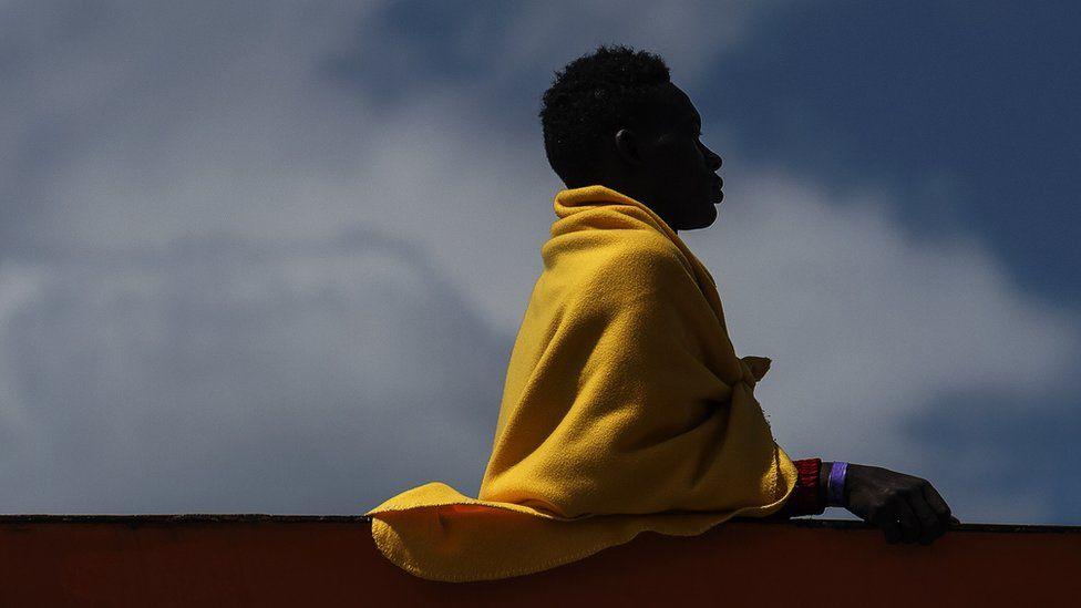 A migrant in the Italian port of Salerno.