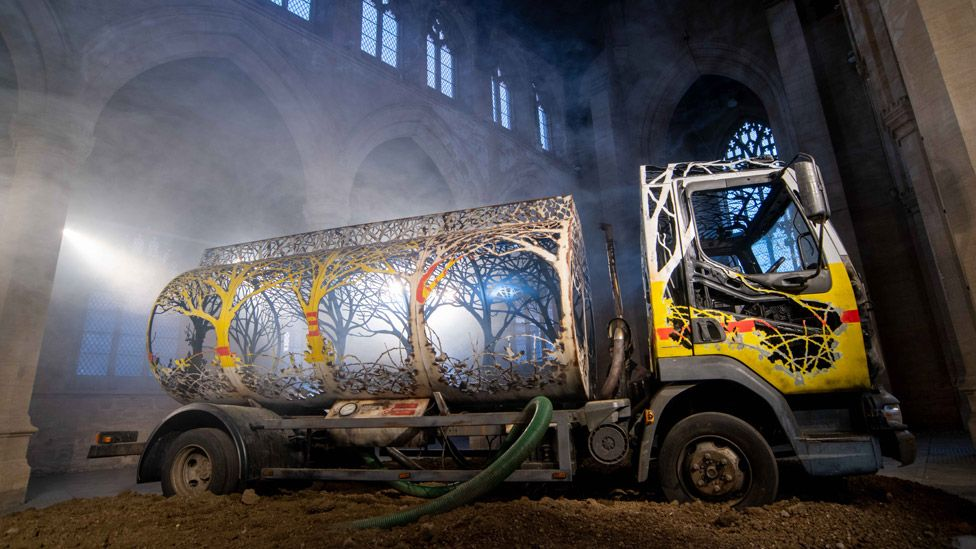 An old petrol tanker lorry has been carved up so that its sides and tank now take on the ethereal shapes of trees.