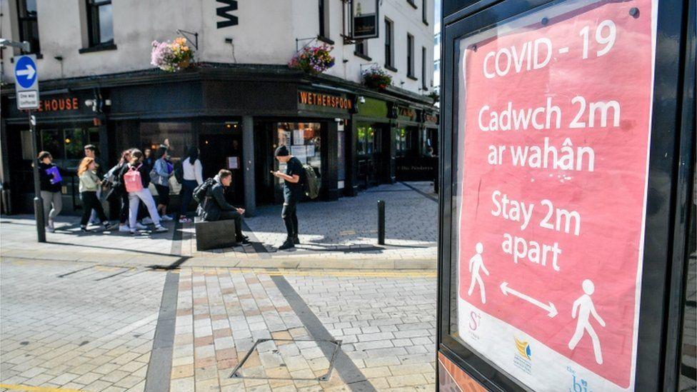A Covid-19 poster opposite a pub in Merthyr Tydfil
