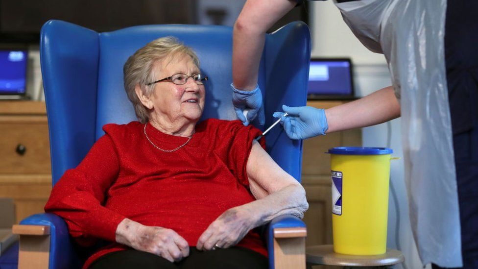 Resident Annie Innes, 90, receives the Pfizer/BioNTech COVID-19 vaccine at the Abercorn House Care Home on December 14, 2020 in Hamilton, Scotland