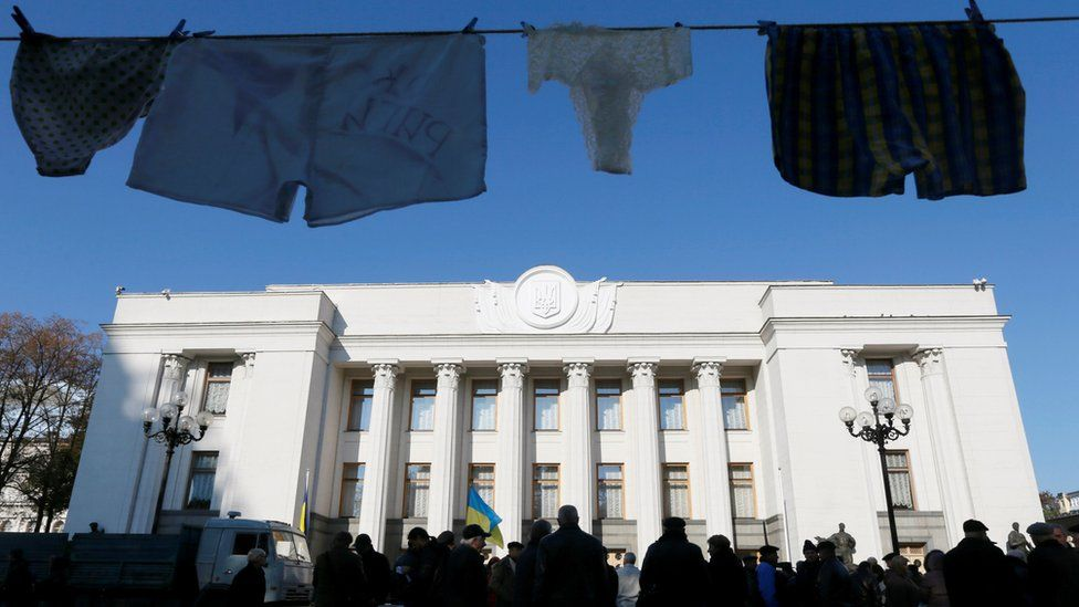 Underwear hung by anti-corruption activists is on display during a rally to demand officials register their income declarations in the e-declaration system in front of the Ukrainian parliament building in Kiev, Ukraine, October 18, 2016