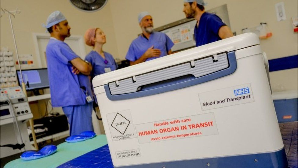NHS staff and organ being delivered