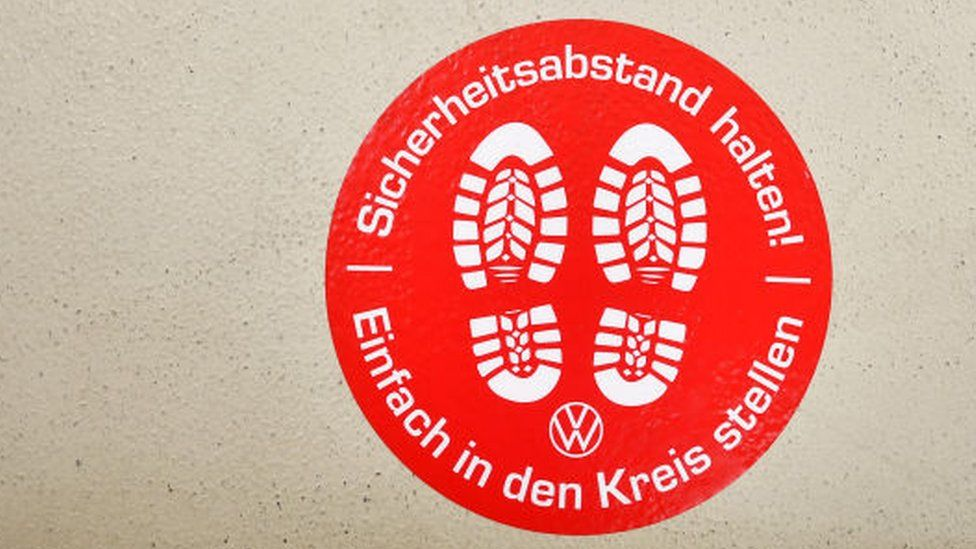 A sign at Volkswagen's Wolfsburg factory reminding staff to keep a safe distance from others