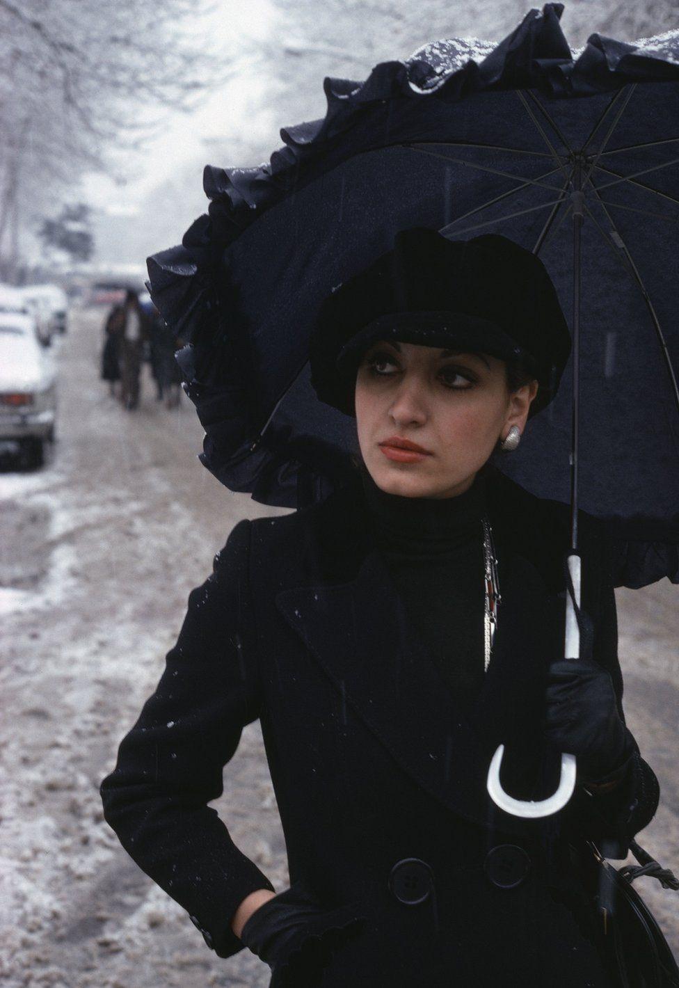 Stylish student walks in the snow in Tehran in 1976