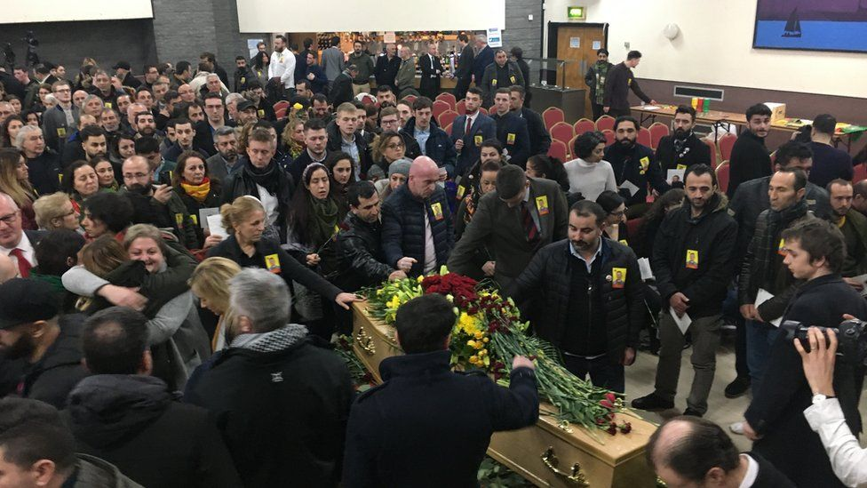 Jac Holmes' funeral service at a community centre in Wimborne