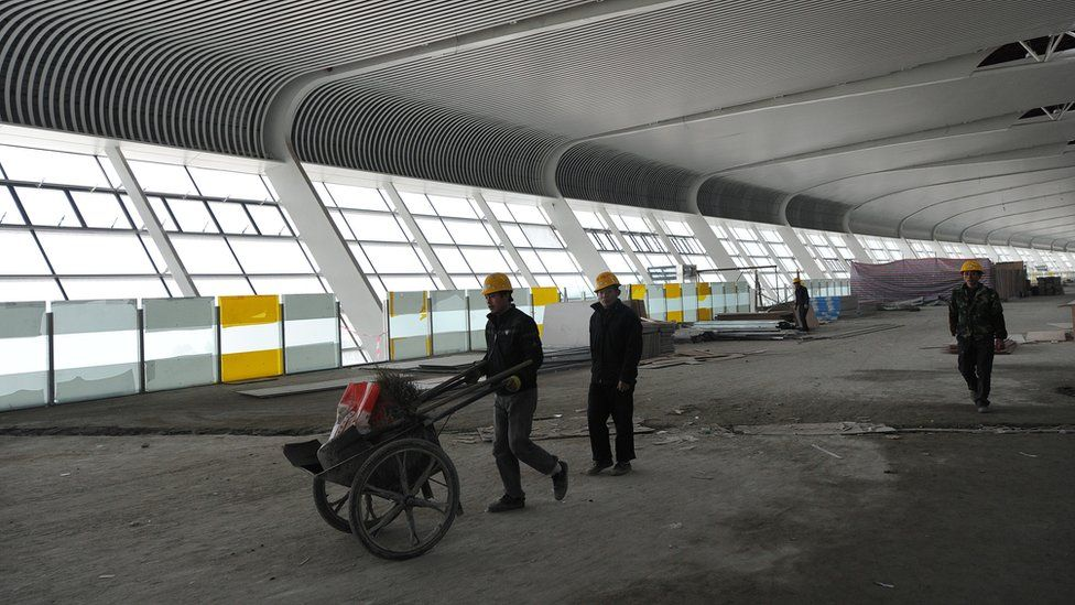 Workers building a new airport in Hefei, in China's Anhui province