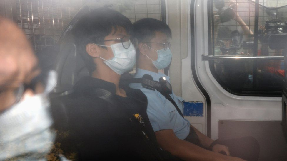 Former convenor of pro-independence group Studentlocalism, Tony Chung Hon-lam arrives at West Kowloon Magistrates' Courts in a police van after he was arrested under the national security law, in Hong Kong, China October 15, 2020.