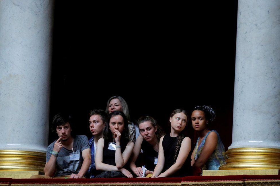 Swedish environmental activist Greta Thunberg, Ivy-Fleur Boileau, Virgile Mouquet, Adelaide Charlier and Alicia Arquetoux - French activists from the Youth for Climate movement - attend the questions to the government session at the National Assembly in Paris, France, 23 July 2019.