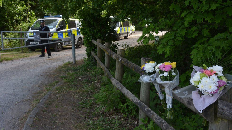 Flowers have been left at Havant Thicket where a body was found