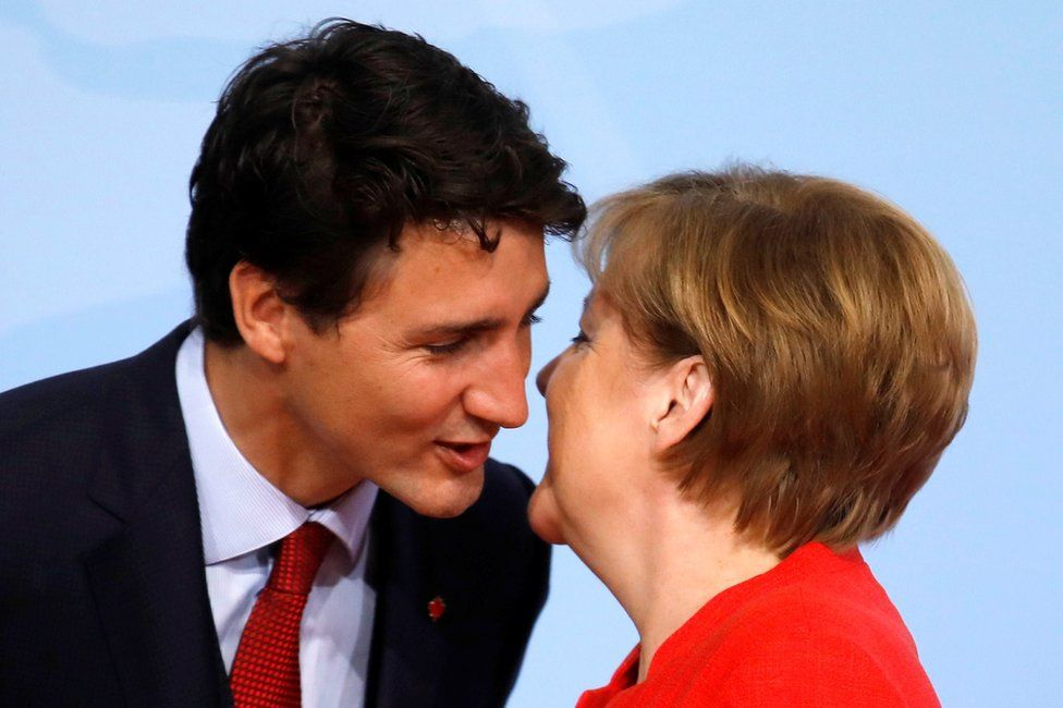 German Chancellor Angela Merkel welcomes Canadian Prime Minister Justin Trudeau at the G20 summit in Hamburg, Germany, 7 July