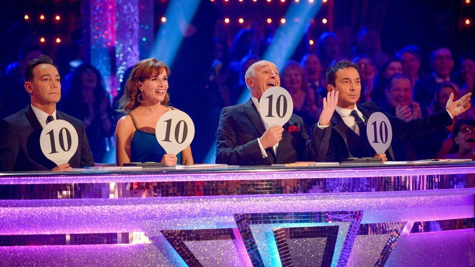 Strictly Come Dancing judges holding up 10s
