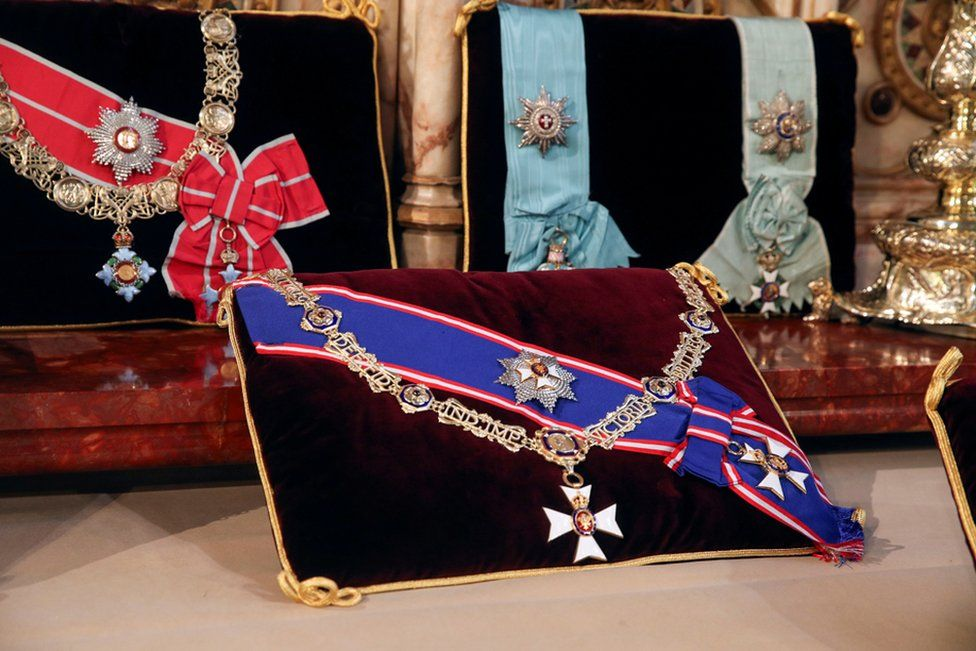 Insignia belonging to Prince Philip, the Royal Victorian Order Collar and Badge, and the Royal Victorian Order Breast Star and Badge (front) and The Order of the Elephant (Denmark), and the Order of the Redeemer (Greece), are placed on the altar in St George's Chapel, Windsor