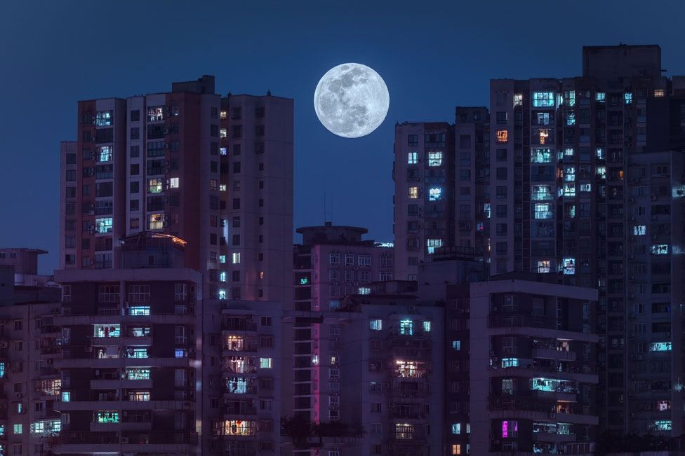 Residential buildings lit up by the supermoon in Chongqing, China