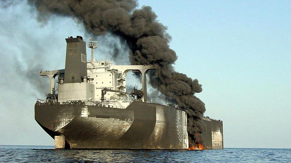 Smoke billows from the French-owned Limburg oil tanker off the coast of the Yemeni port of al-Mukalla, after an explosion that killed one and injured 12 others, 6 October 2002