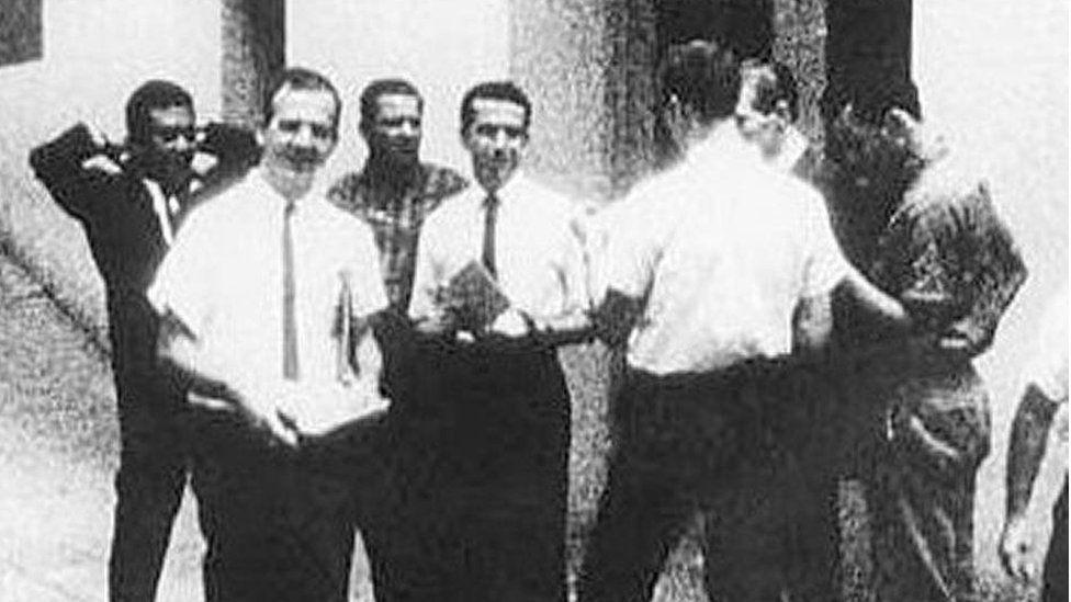 Lee Harvey Oswald, front left, standing next to man never identified by the Warren Commission, centre in white shirt, handing out leaflets for the Fair Play for Cuba Committee
