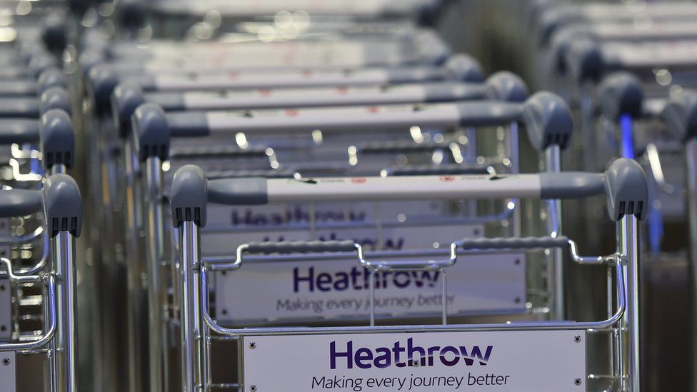 Baggage trolleys stand in rows in the baggage reclaim hall at Terminal Two at Heathrow Airport west of London on April 23, 2014.