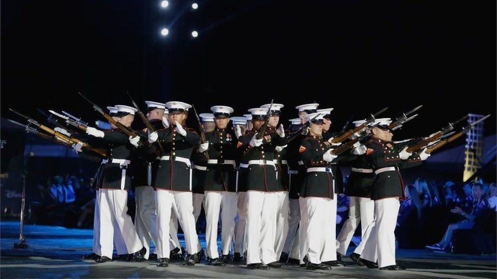 The US Marine Corps silent drill team also performed