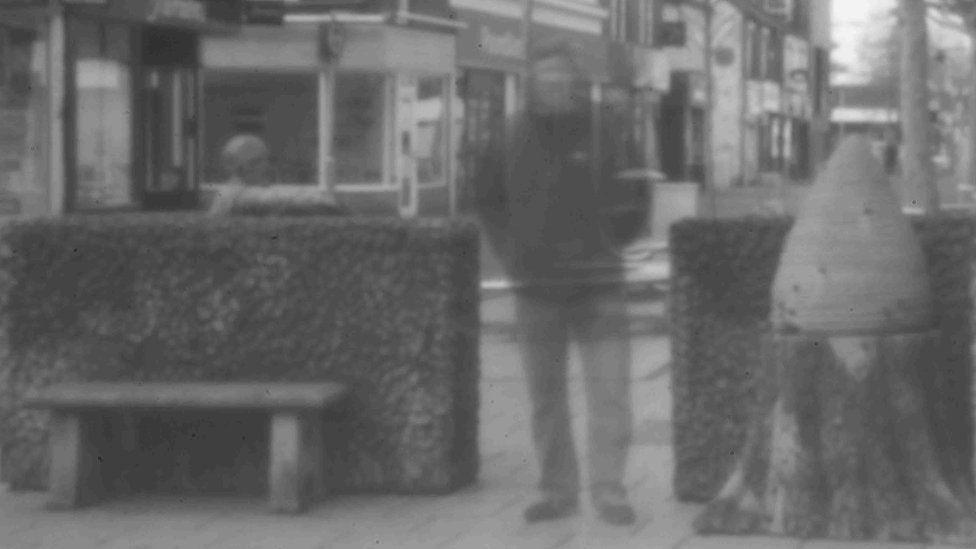 Pinhole photo of man on street