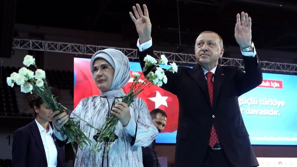Turkish President Tayyip Erdogan, with his wife Emine Erdogan, greet supporters at a meeting to announce his ruling Ak Party's manifesto for next month's election in Ankara, Turkey, 24 May 2018