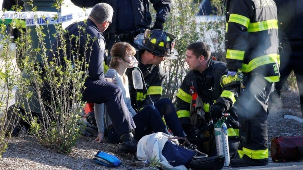 An injured woman is treated by first responders