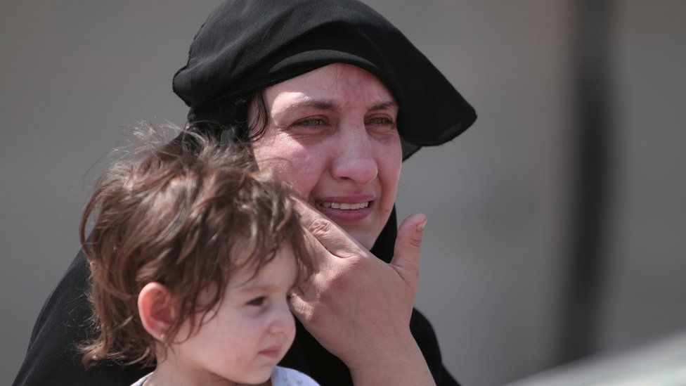 A woman after being evacuated from Manbij.