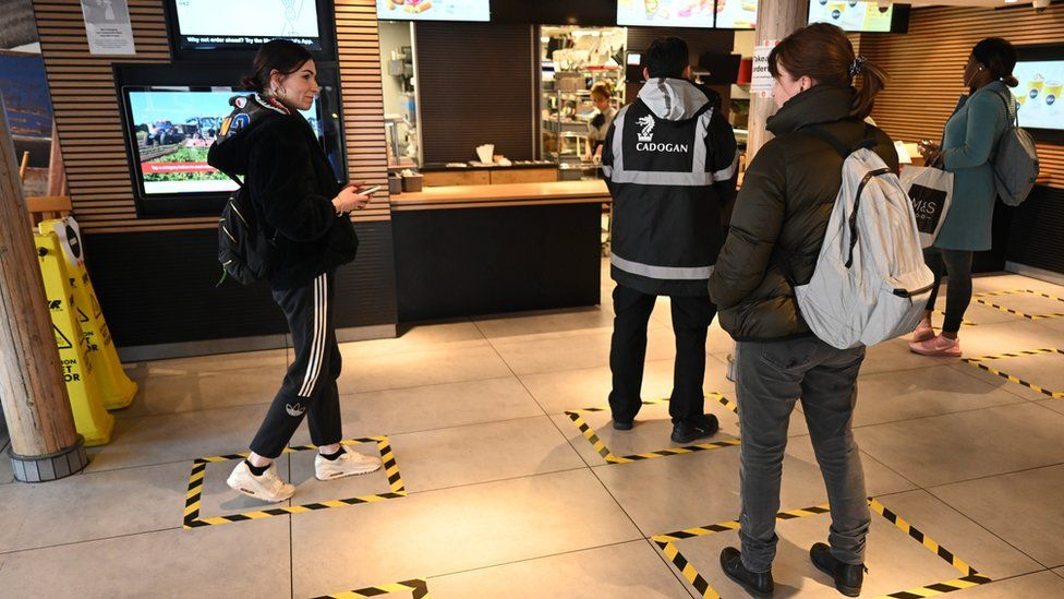 "Tape marks the floor where customers should stand to practice social distancing to reduce the risk of spreading coronavirus at a McDonald""s restaurant in London, Britain"