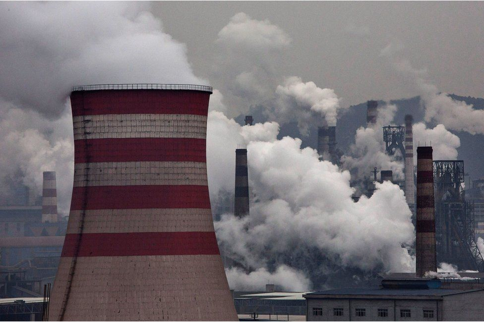 Smoke billows from smokestacks and a coal fired generator at a steel factory on 19 November 2015 in the industrial province of Hebei, China.