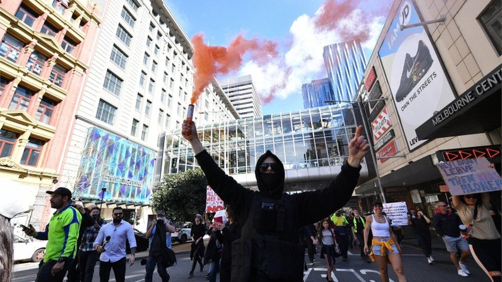 Protesters gather during an anti-lockdown protest in the central business district of Melbourne, Australia, 21 August 2021