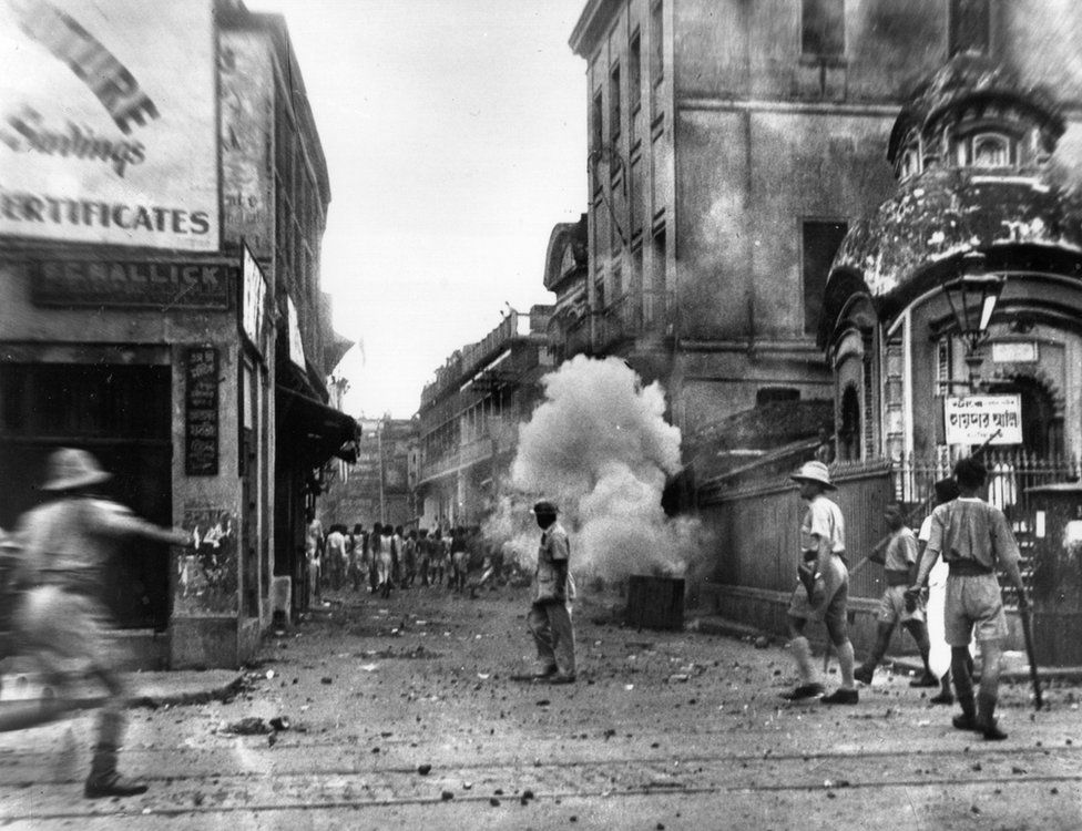 Policemen use tear gas bombs during the communal riots in Kolkata (Calcutta) ahead of Partition