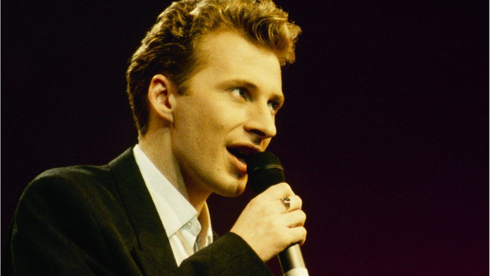 Colin Vearncombe, known as Black, performing on stage in around 1987