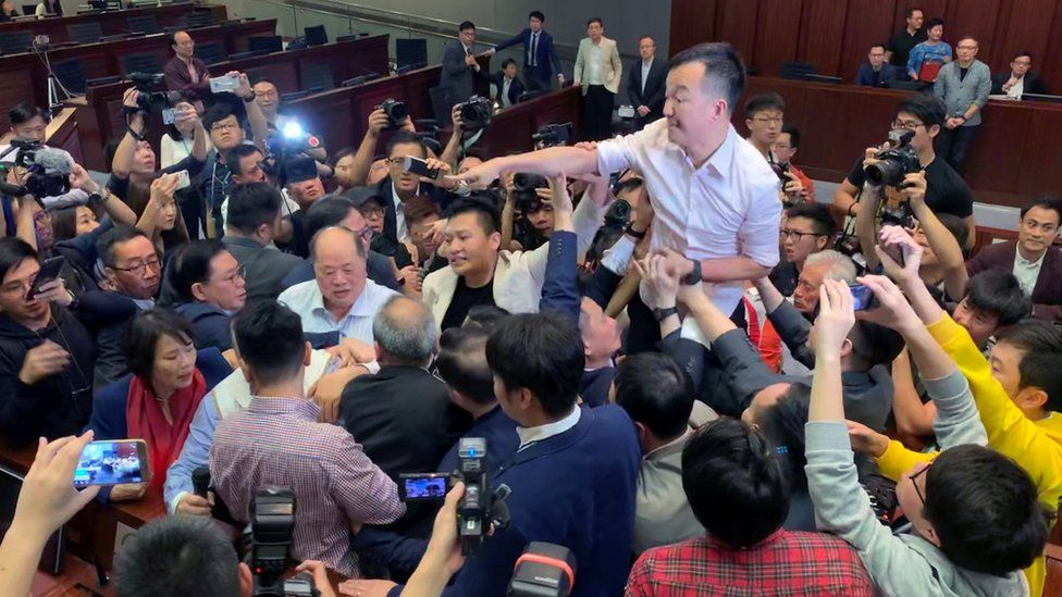 Scuffles broke out in Hong Kong's legislature over proposed changes to extradition laws