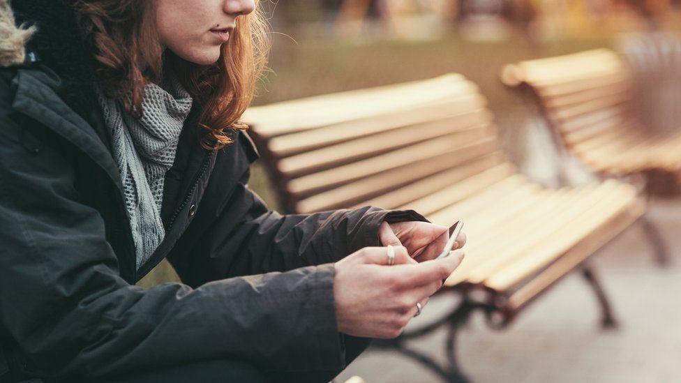 Girl sitting on bench (stock image)