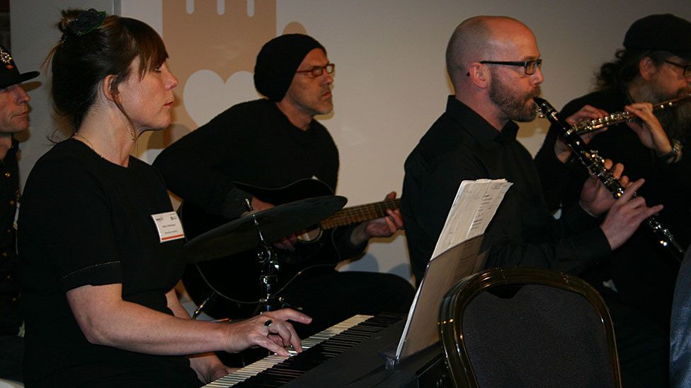 Molly Mathieson (left) and the New Note Orchestra