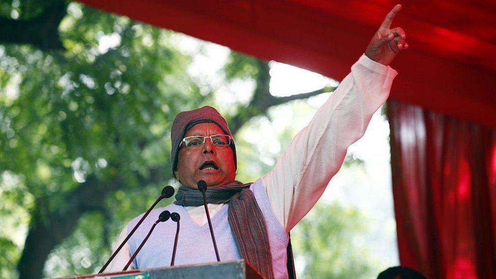 RJD President Lalu Prasad Yadav addressing the supporters during the protest by Janta Parivar against Modi Government at Jantar Mantar on December 22, 2014 in New Delhi, India.