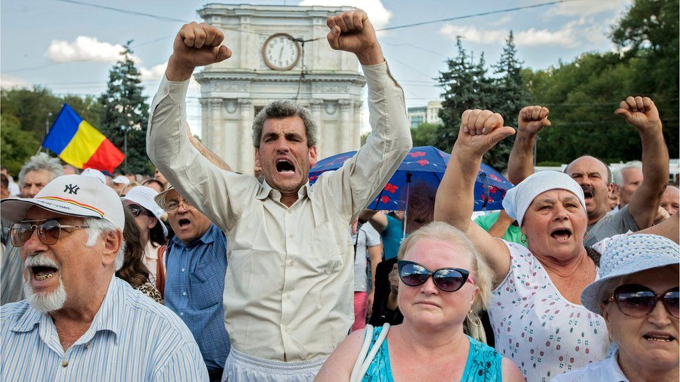 People shout anti-government slogans at the protest in Moldova