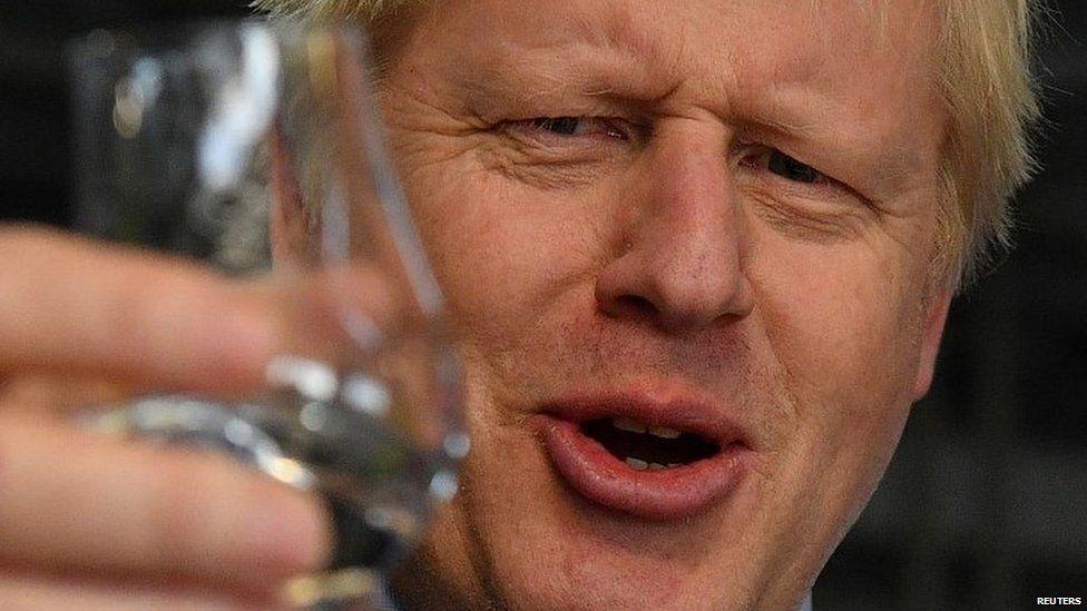 Boris Johnson during a visit to a distillery near Elgin
