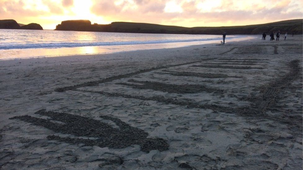 Soldier artwork on St Ninian's beach, Shetland