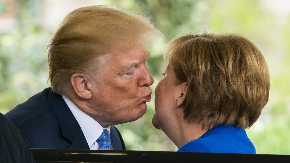 US President Donald J. Trump (L) welcomes German Chancellor Angela Merkel (R) at the West Wing of the White House in Washington, DC, USA, 27 April 2018