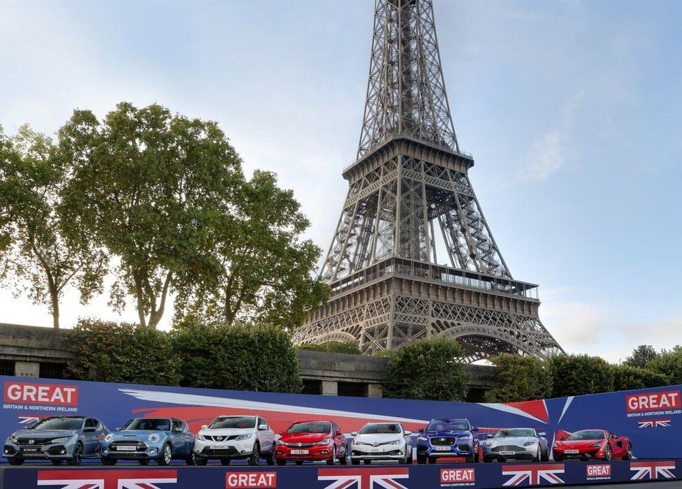 British-made cars in front of the Eiffel Tower
