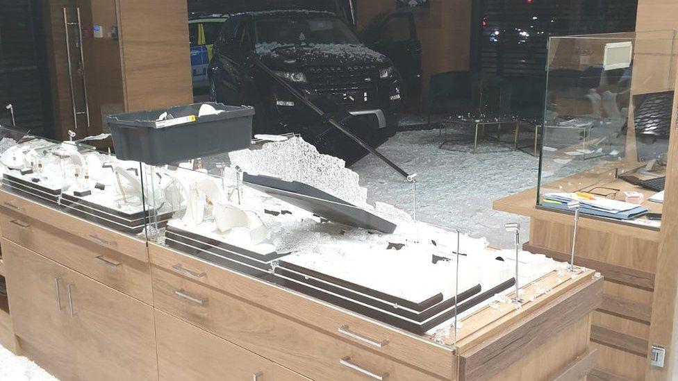 Car driven into shop