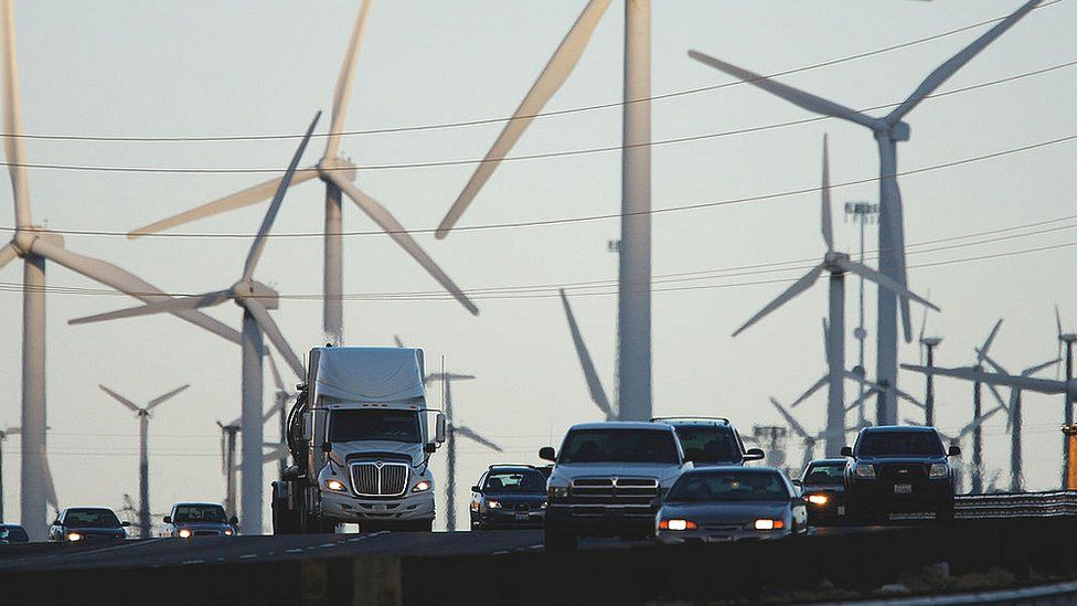 Traffic passing wind turbines in the US