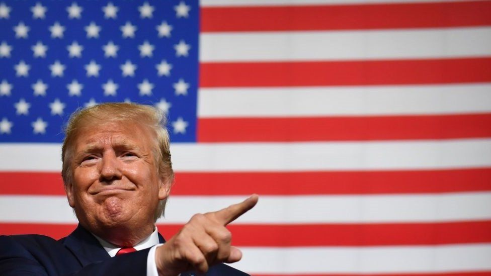 """US President Donald Trump speaks during a """"Keep America Great"""" campaign rally at the SNHU Arena in Manchester, New Hampshire, on August 15, 2019"""